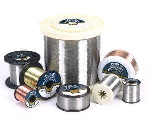 Several sizes of spools and bobbins for stainless steel wire
