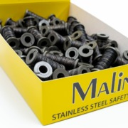 A box of small spools of Malin safety wire   Lock wire products